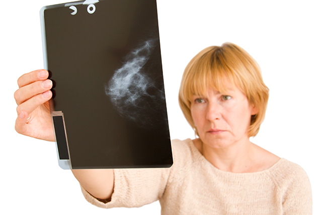 A patient reviews a breast screening result.