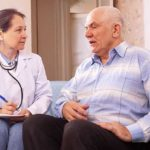 Conferring with an older patient with cancer.