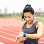 A cancer survivor consults her fitness tracker.
