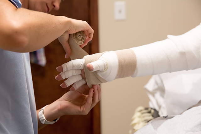 A patient receives lymphedema treatment.