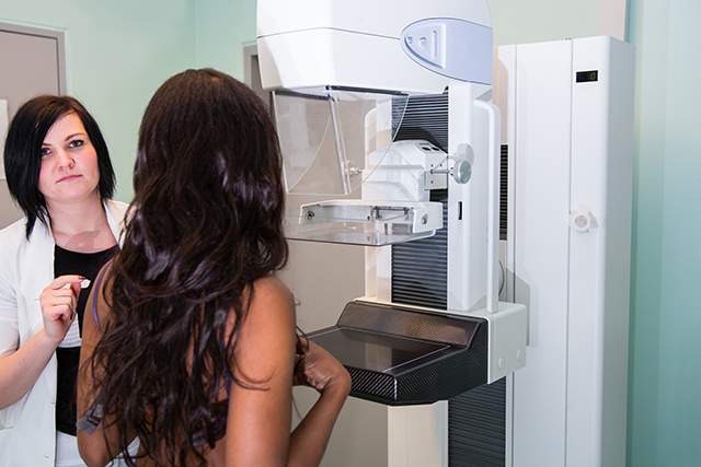 A woman undergoes a routine mammography.
