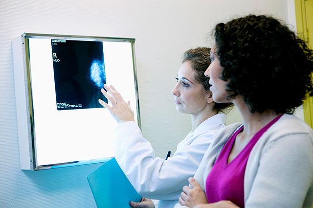 A patient receives their mammography results.