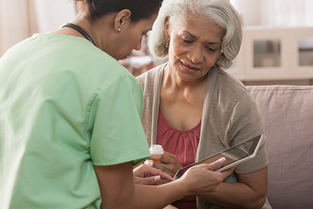 A nurse discusses medication dosage with a patient.
