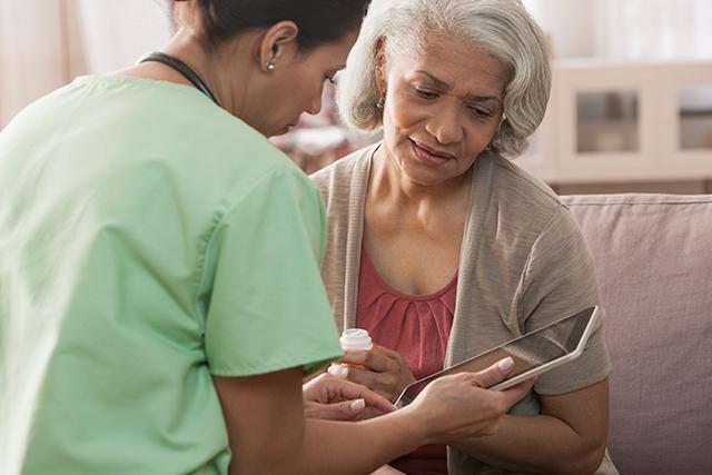 A nurse discusses medication dosage with a patient.