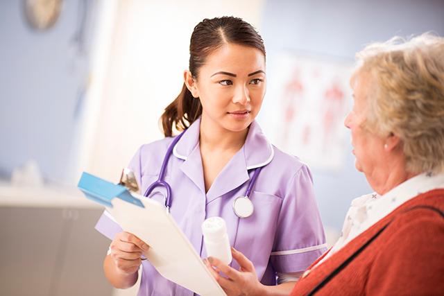 Reviewing a prescription with an older patient.