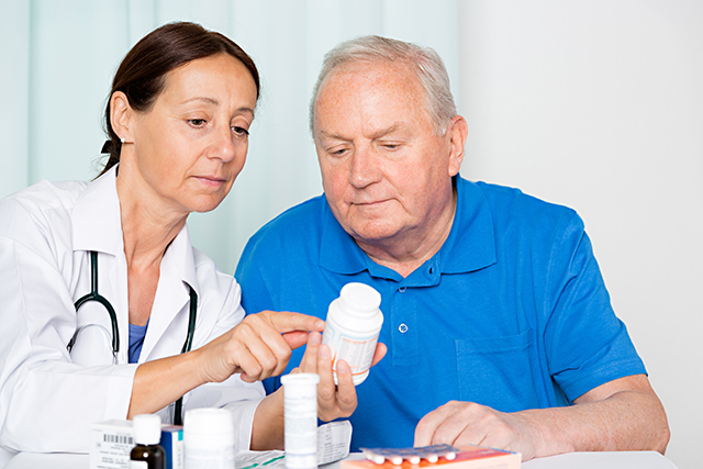 Discussing medication with a patient.