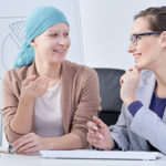 Advising a patient on the effects of their cancer treatment.
