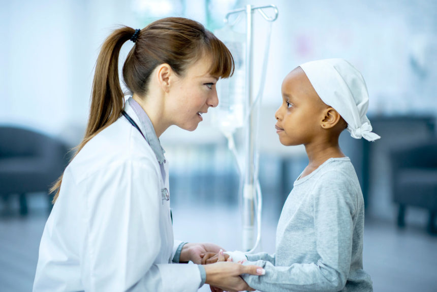 Comforting a young patient with cancer.