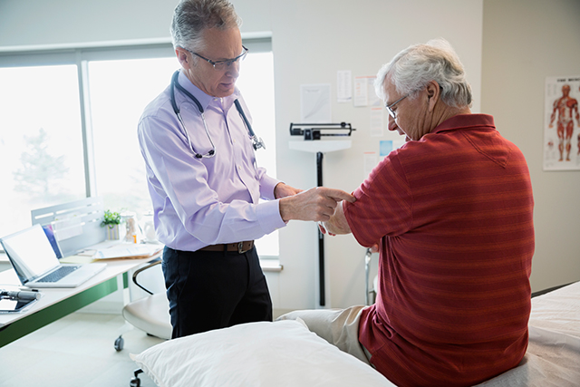 An older patient speaks to doctor about loss in muscle mass.
