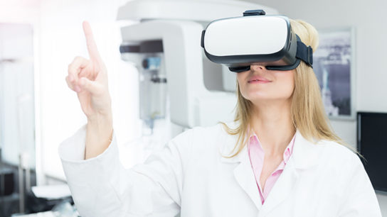 An oncologist tests a virtual reality headset.