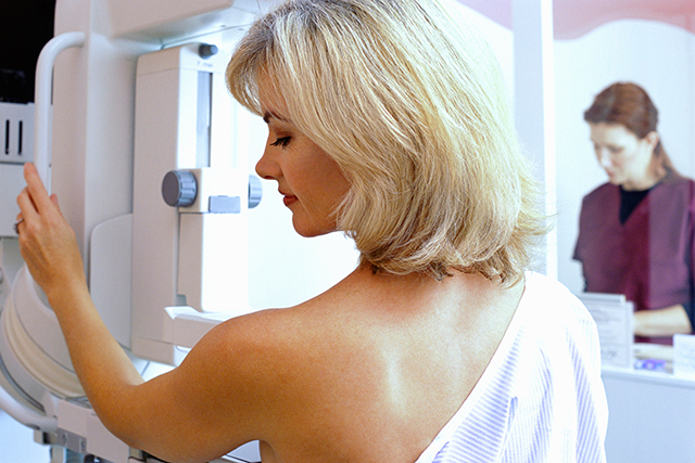 Preparing for a mammography.