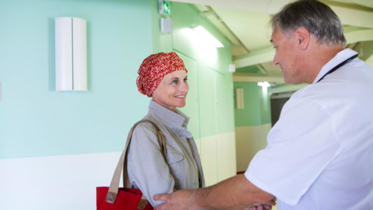 Discussing lifestyle changes with a cancer survivor.
