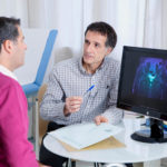 Advising a patient on prostate cancer treatments.