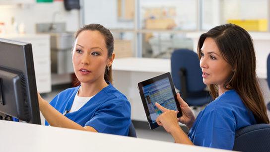 Nurses discuss an oncology care plan.