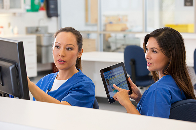 Nurses discuss an oncology care plan.