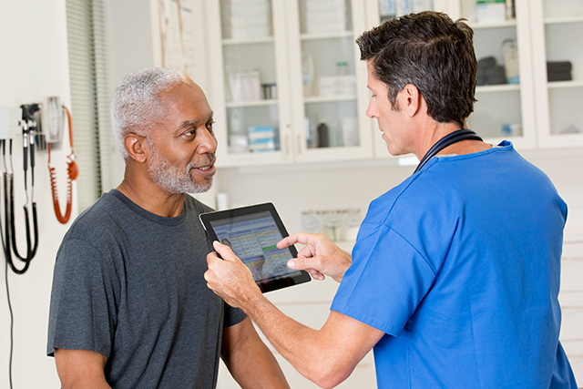 A patient and nurse discuss cancer screening options.