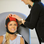 A patient uses the Dignicap scalp cap.