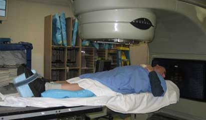 The author positioned for radiation treatment under a linear accelerator.