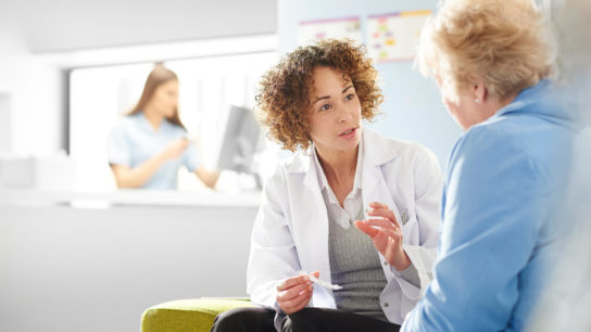 Discussing treatment with a patient.