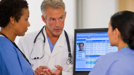 Reviewing a patient's electronic health record.