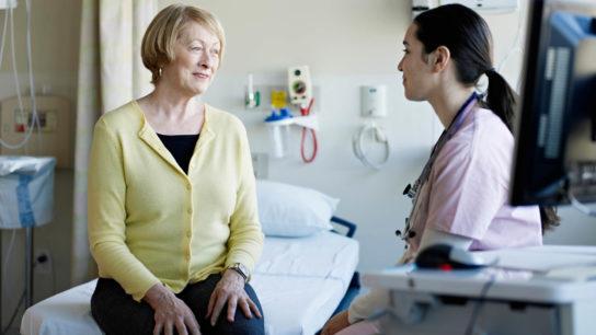 A nurse speaks with a patient.