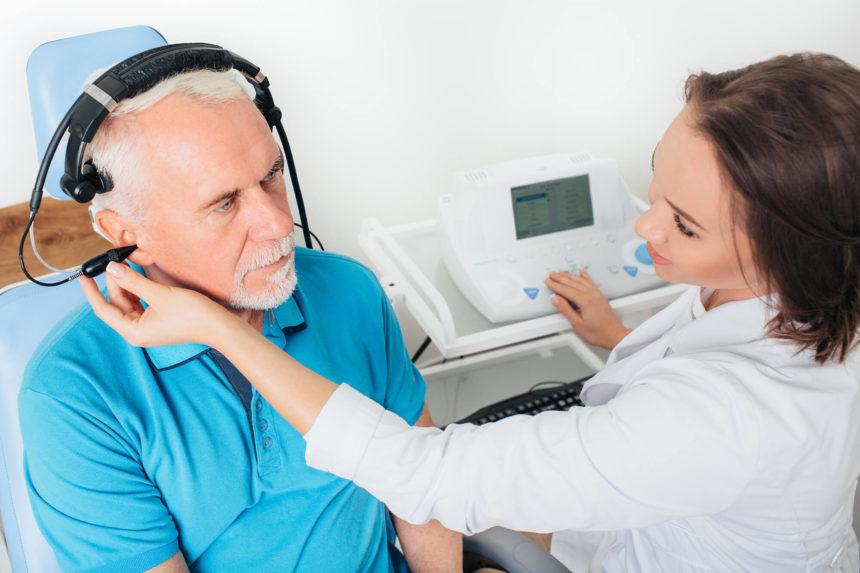 Senior man in hospital having a hearing test.