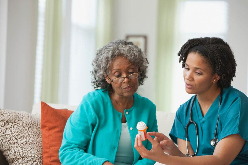 A nurse reviews a prescription with a patient.
