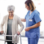 A mobility tech can assist in patient ambulation.
