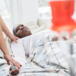 Hospice nurse checks on senior female patient.