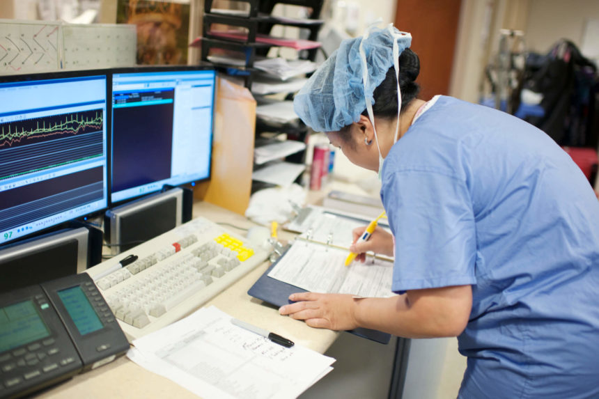 Doctor examining electronic health records.